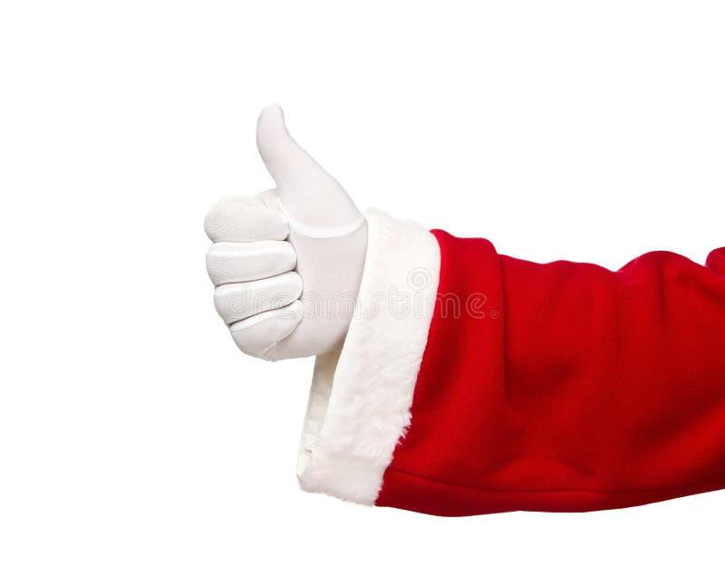 Il Babbo Natale che mostra i pollici su fotografia stock