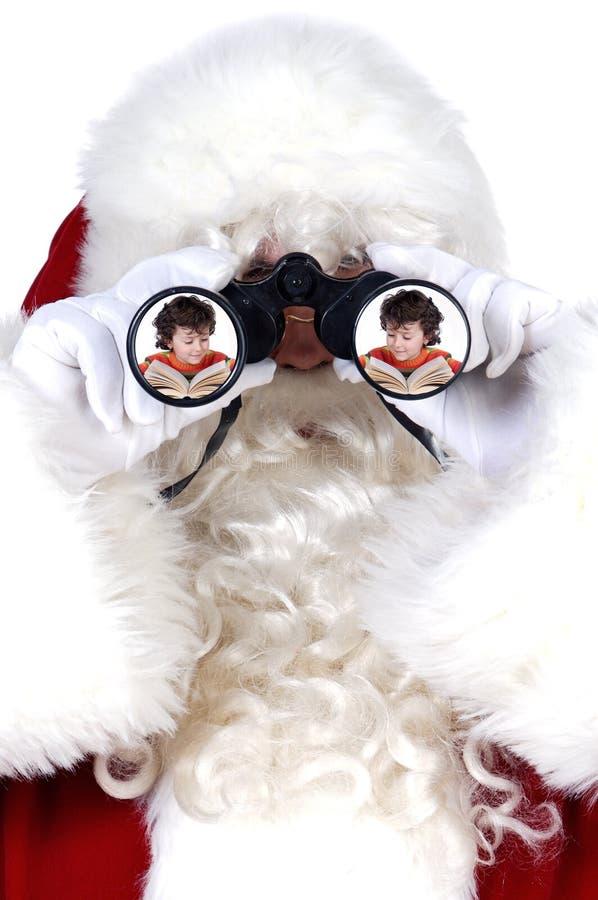 Il Babbo Natale con il binocolo fotografie stock