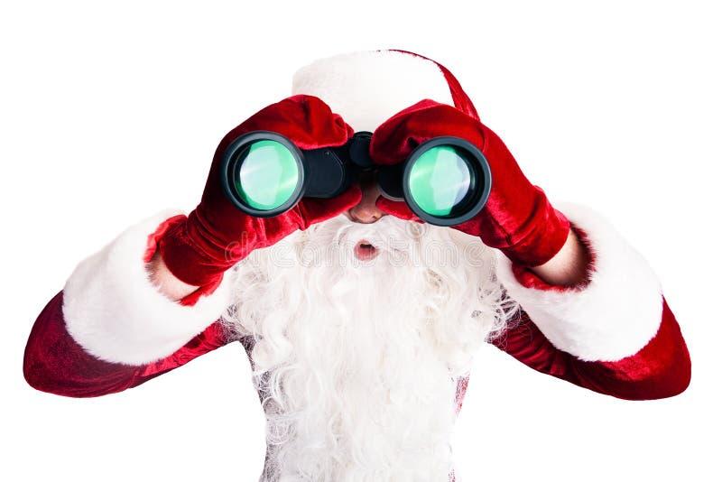 Il Babbo Natale con il binocolo fotografia stock libera da diritti