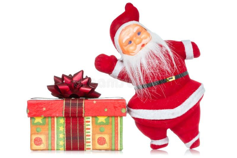 Il Babbo Natale con il regalo di natale fotografia stock libera da diritti