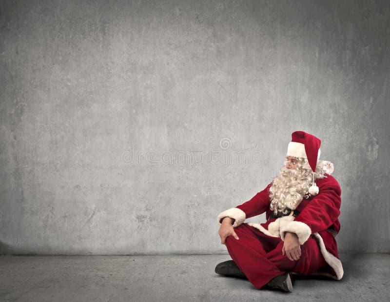 Il Babbo Natale di seduta immagine stock