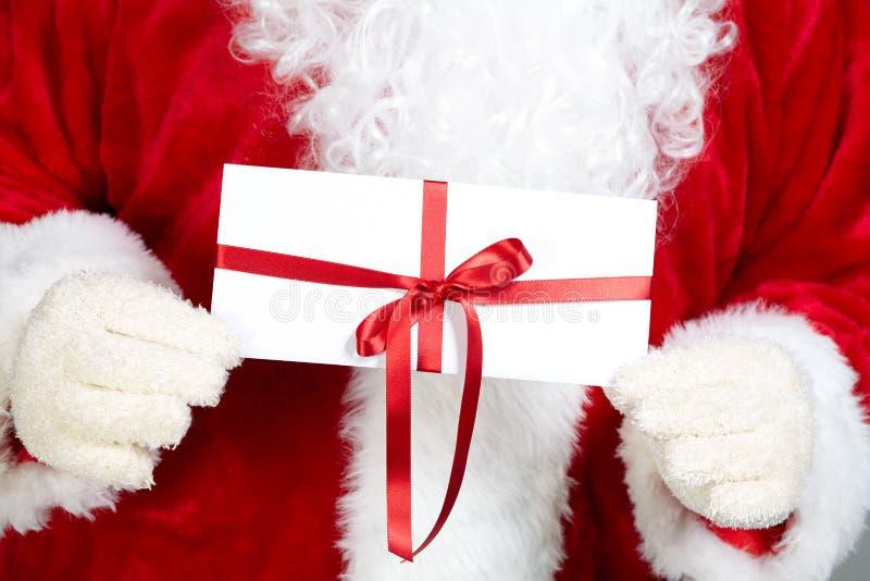 Il Babbo Natale e busta fotografia stock libera da diritti