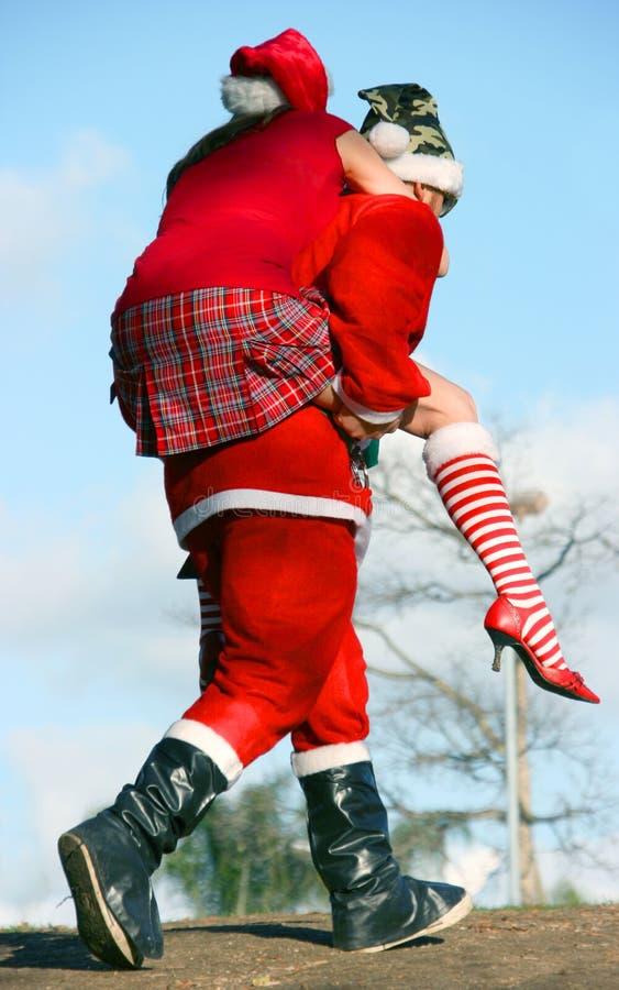 Il Babbo Natale e ragazza della neve immagine stock