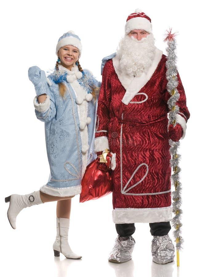Il Babbo Natale e ragazza della neve fotografia stock