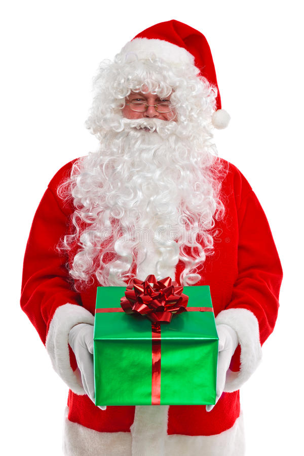 Il Babbo Natale gli che dà un regalo fotografia stock