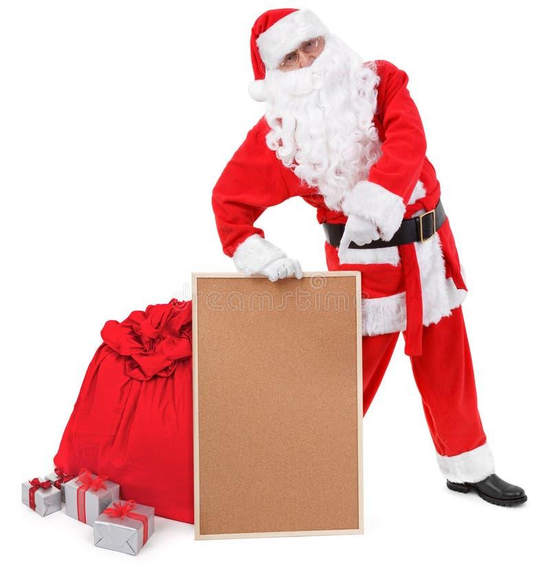 Il Babbo Natale mostra l'albo vuoto immagine stock libera da diritti