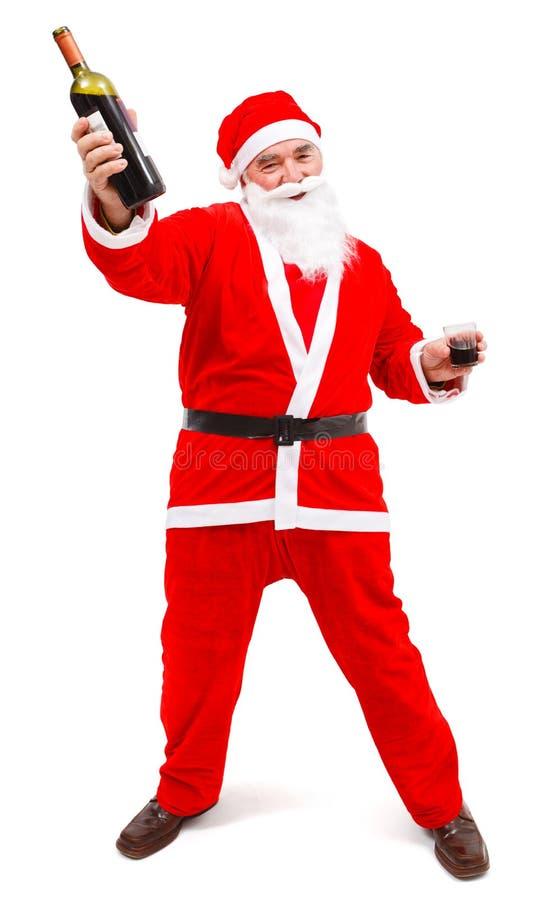 Il Babbo Natale ubriaco con la bottiglia di vino fotografia stock