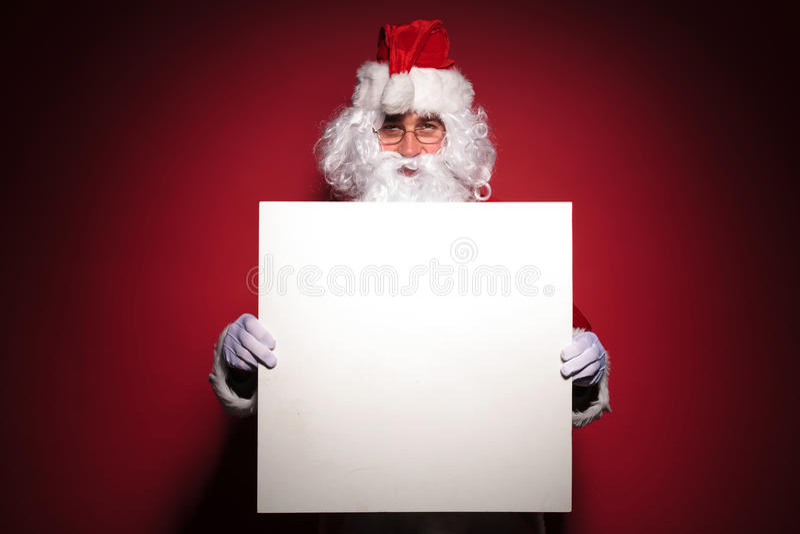 Il Babbo Natale vi che mostra un segno in bianco fotografia stock libera da diritti