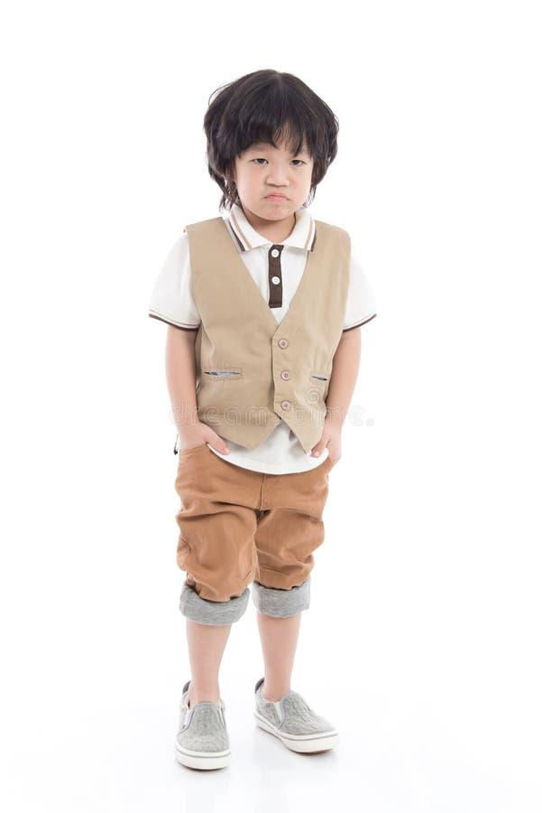 Il bambino asiatico sta annoiandosi fotografie stock libere da diritti