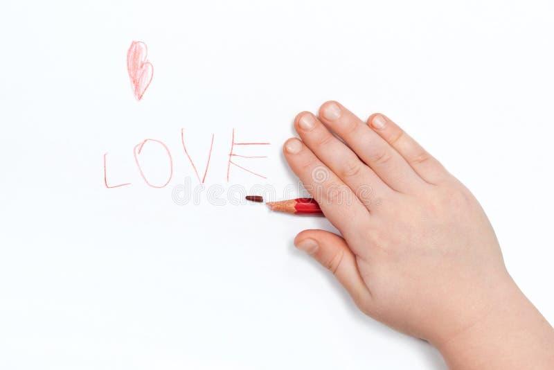 Il bambino ha scritto l'amore fotografia stock