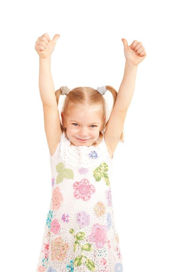 Il bambino sorridente che mostra i pollici aumenta il simbolo immagine stock libera da diritti