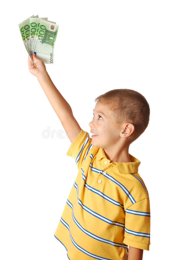 Il bambino tiene i soldi fotografia stock