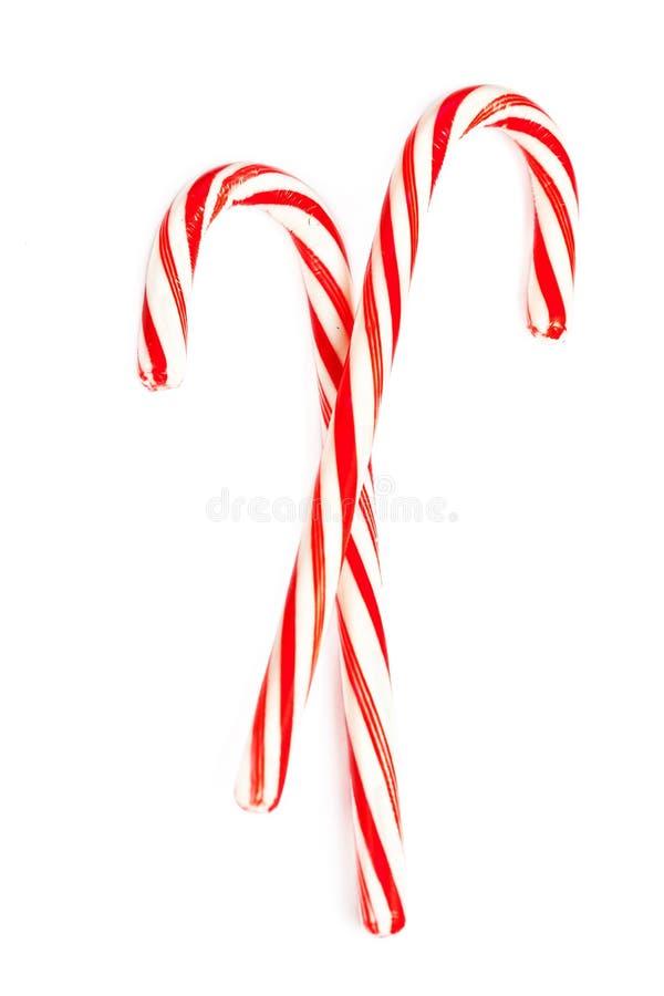 Il bastoncino di zucchero duro della menta di Natale ha barrato isolato su un backg bianco fotografie stock libere da diritti