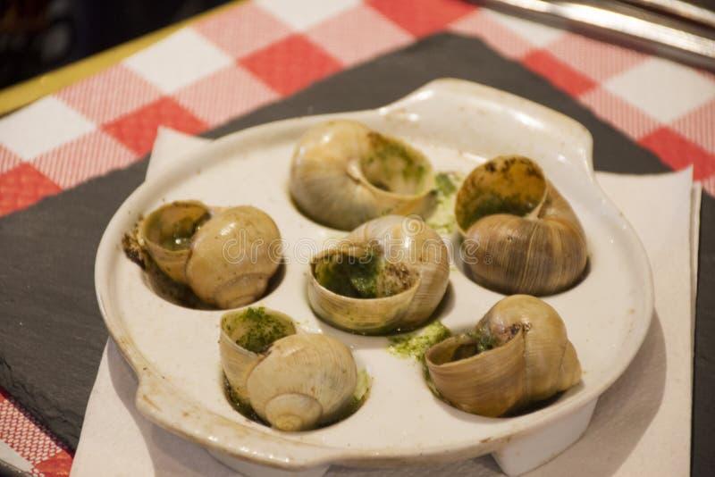 Il beurre dell'Au di lumache, indispone et il persil, Recette o le lumache in aglio e prezzemolo imburrano le ricette fotografie stock libere da diritti