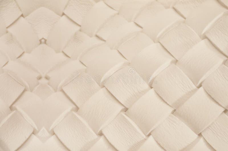 Il bianco ha intrecciato la superficie di cuoio come fondo fotografie stock