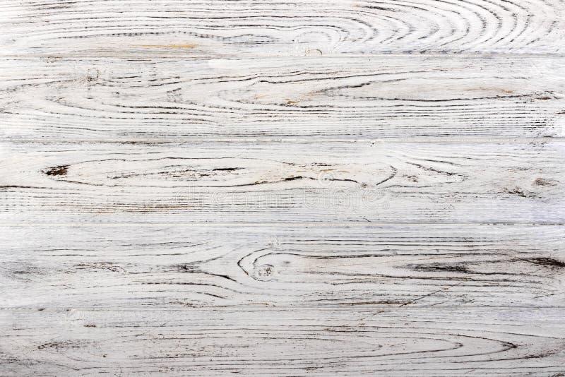 Il bianco misero stagionato d'annata ha dipinto la struttura di legno come fondo immagini stock libere da diritti