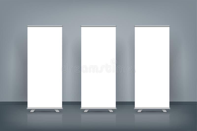 Il in bianco tre rotolare sull'esposizione dei manifesti dell'insegna in parete blu scuro, deride su royalty illustrazione gratis