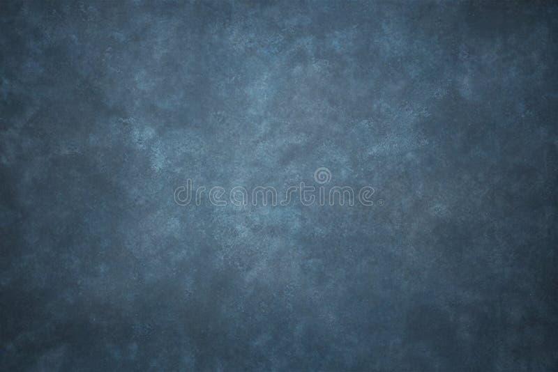 Il blu ha dipinto il contesto dello studio del panno del tessuto della mussola o della tela fotografia stock libera da diritti