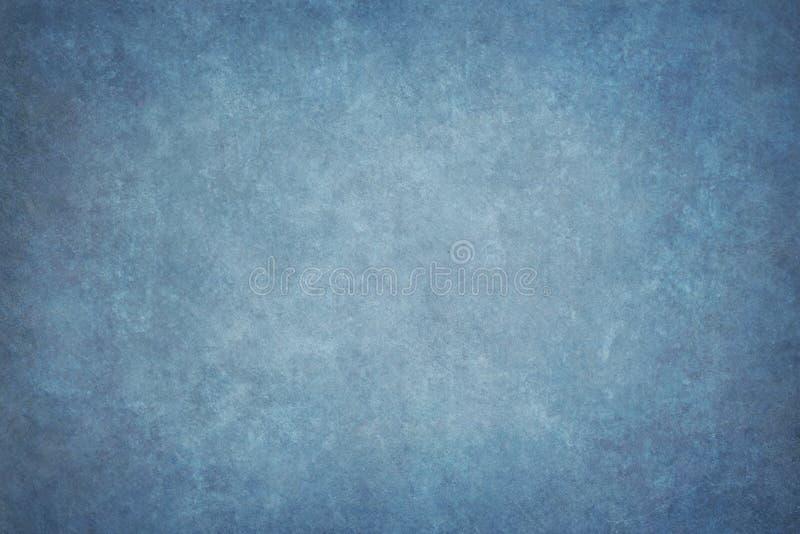 Il blu ha dipinto il contesto dello studio del panno del tessuto della mussola o della tela immagine stock libera da diritti