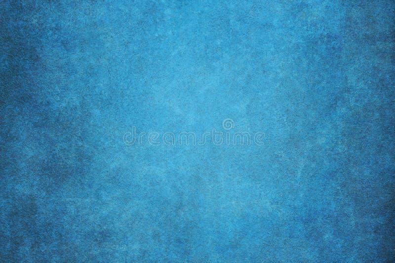 Il blu ha dipinto il contesto dello studio del panno del tessuto della mussola o della tela fotografie stock libere da diritti
