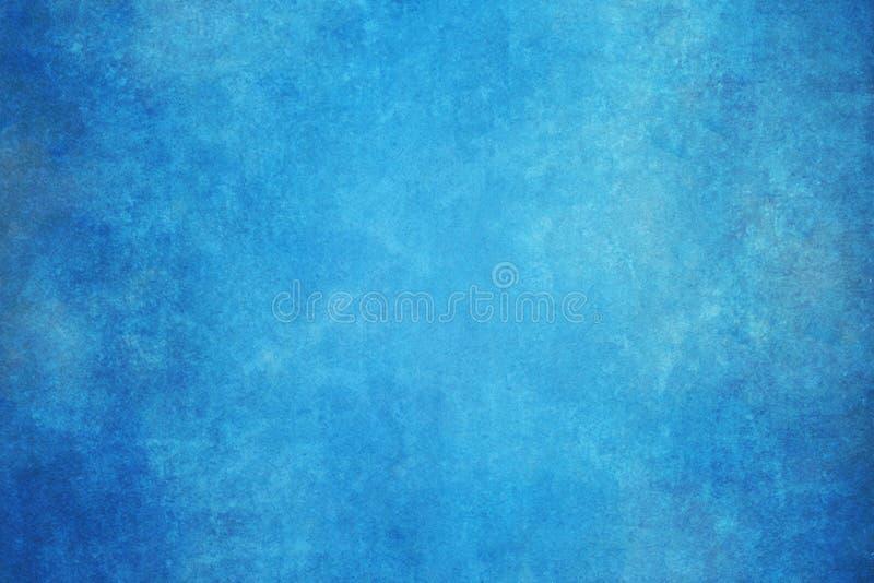 Il blu ha dipinto il contesto dello studio del panno del tessuto della mussola o della tela immagini stock libere da diritti