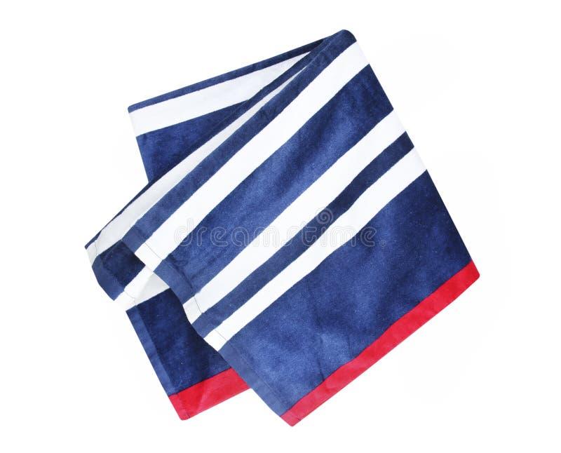 Il blu ha spogliato l'asciugamano di spiaggia piegato isolato immagini stock libere da diritti