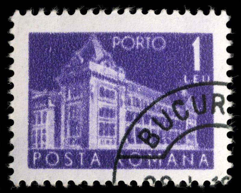 Il bollo stampato in Romania mostra una posta centrale della Romania immagini stock libere da diritti