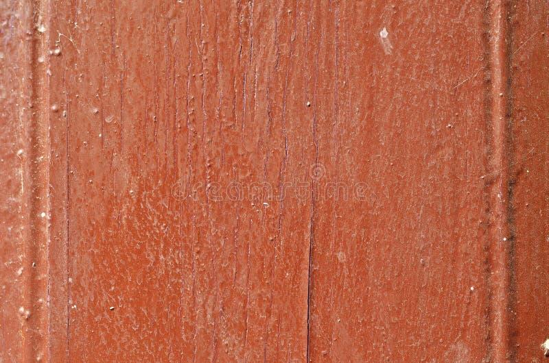 Il bordo di legno è coperto di pittura marrone, una struttura fotografie stock libere da diritti