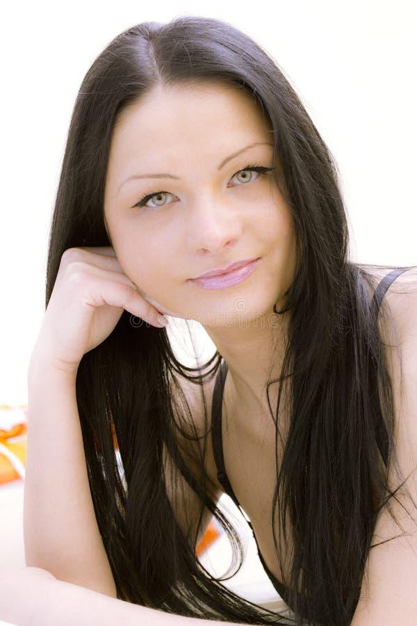 Il brunette interno immagini stock