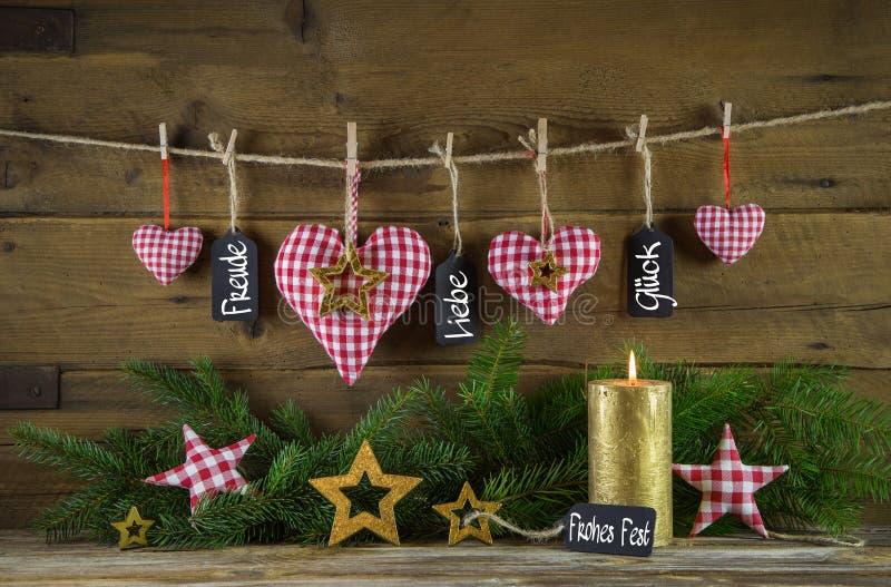 Il Buon Natale carda con testo tedesco: felicità, amore e fortuna fotografia stock