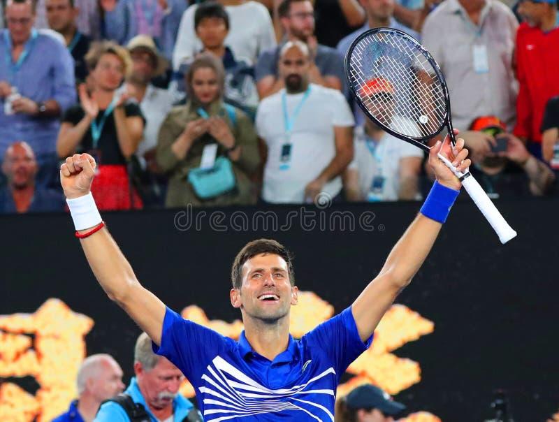 il campione Novak Djokovic di Grand Slam di 14 volte della Serbia celebra la vittoria dopo la sua partita di semifinale all'Austr immagine stock libera da diritti