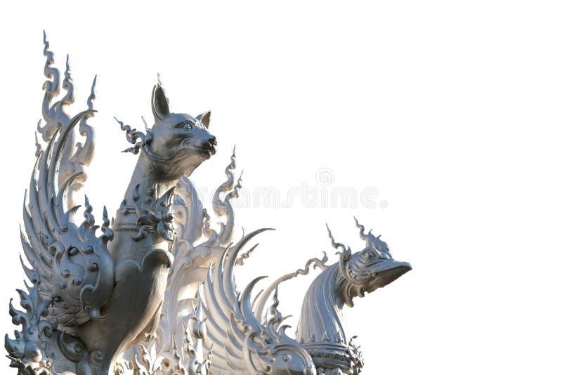 Il cane mistico ed il gallo su un tetto completano immagini stock
