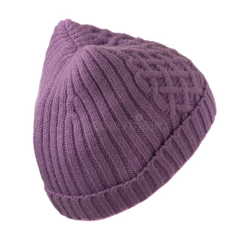 Il cappello tricottato delle donne isolato su fondo bianco Cappello porpora fotografie stock libere da diritti
