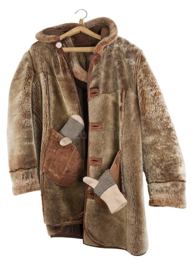 Il cappotto di pelliccia femminile è parte interna girata - fuori fotografia stock libera da diritti