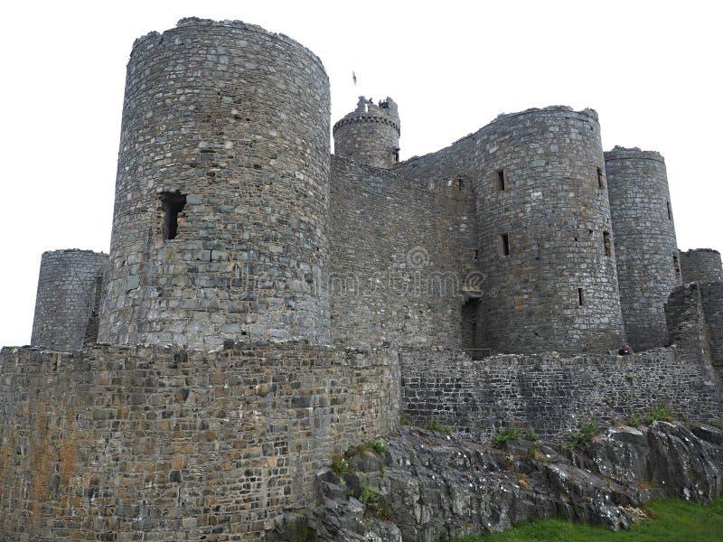Il castello di Harlech situato rovine-spettacolare sembra svilupparsi naturalmente dalla roccia su cui si appollaia Come un tutto immagini stock