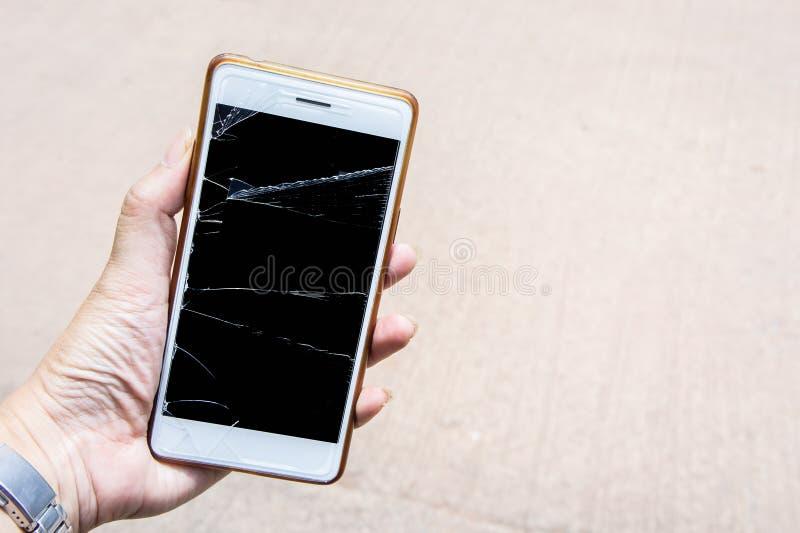 Il cellulare rotto dello schermo, moblle dello schermo è vetro incrinato fotografia stock