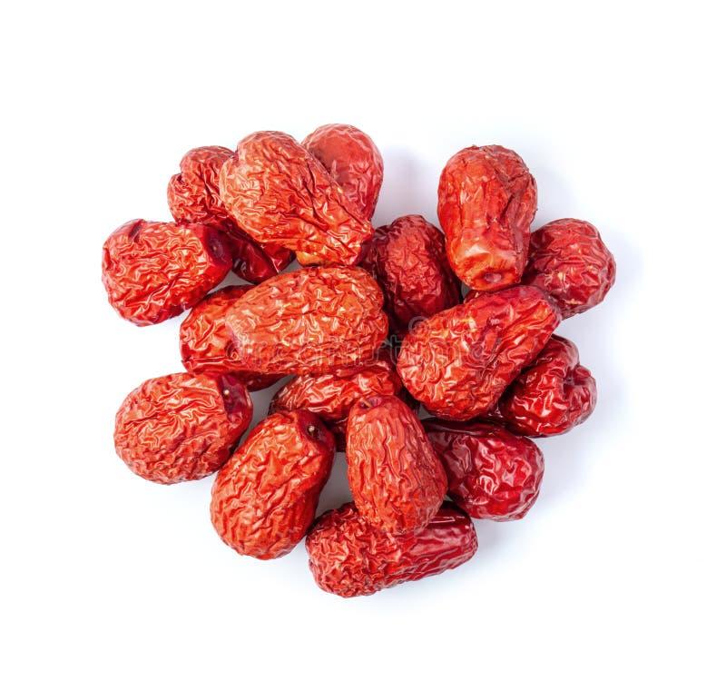 Il cinese della giuggiola ha asciugato la frutta rossa della data su fondo bianco fotografie stock libere da diritti
