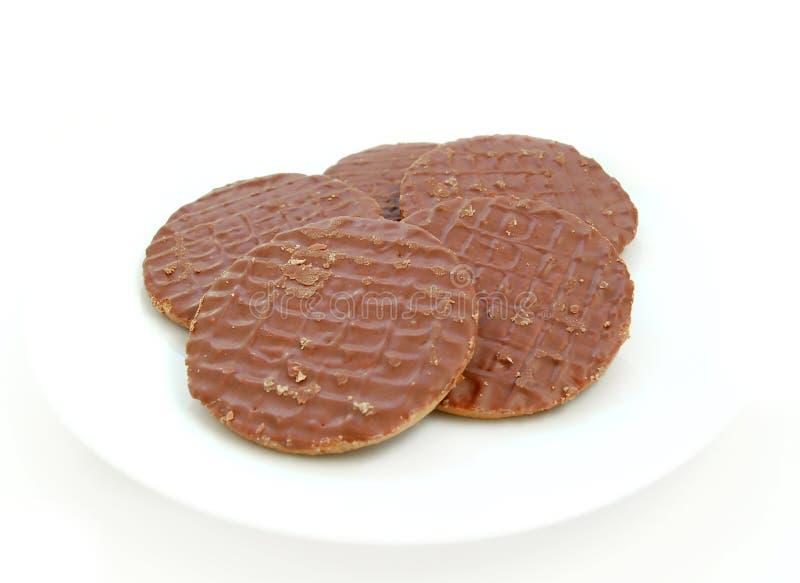 Il cioccolato ha coperto i biscotti fotografie stock libere da diritti