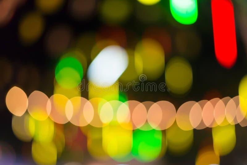 Il colore defocused variopinto accende il fondo del bokeh, luce di Chrismas immagini stock libere da diritti