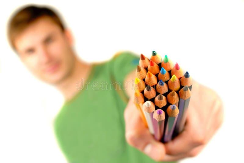 Il colore disegna a matita a disposizione fotografie stock