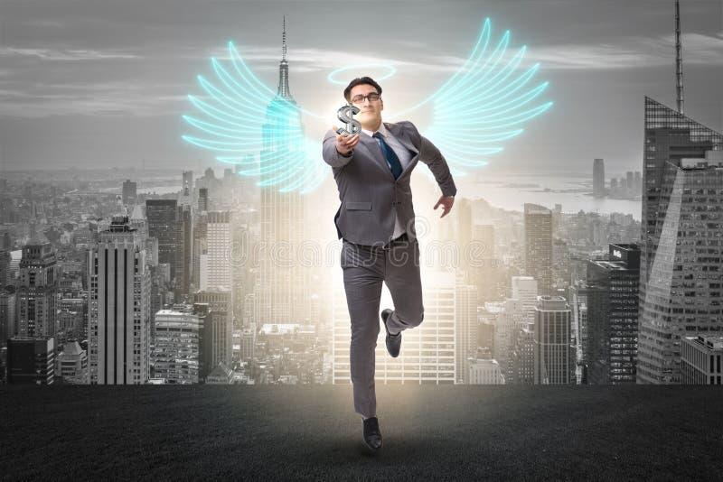 Il concetto dell'investitore di angelo con l'uomo d'affari con le ali immagini stock