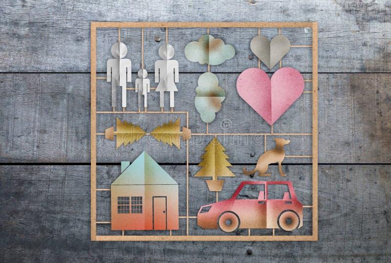 Il concetto della casa dolce casa con la carta dell'icona della famiglia ha tagliato il templat di forma fotografia stock