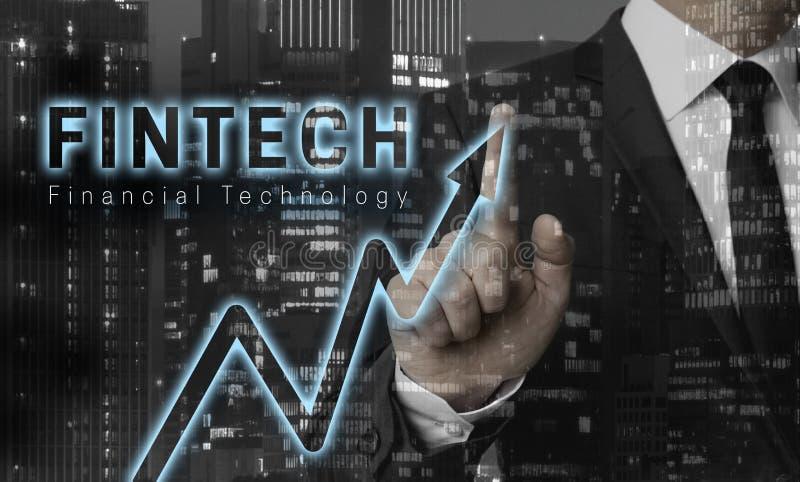 Il concetto di Fintech è indicato dall'uomo d'affari fotografia stock libera da diritti