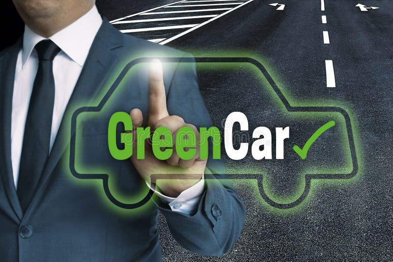 Il concetto di GreenCar è indicato dall'uomo d'affari fotografia stock