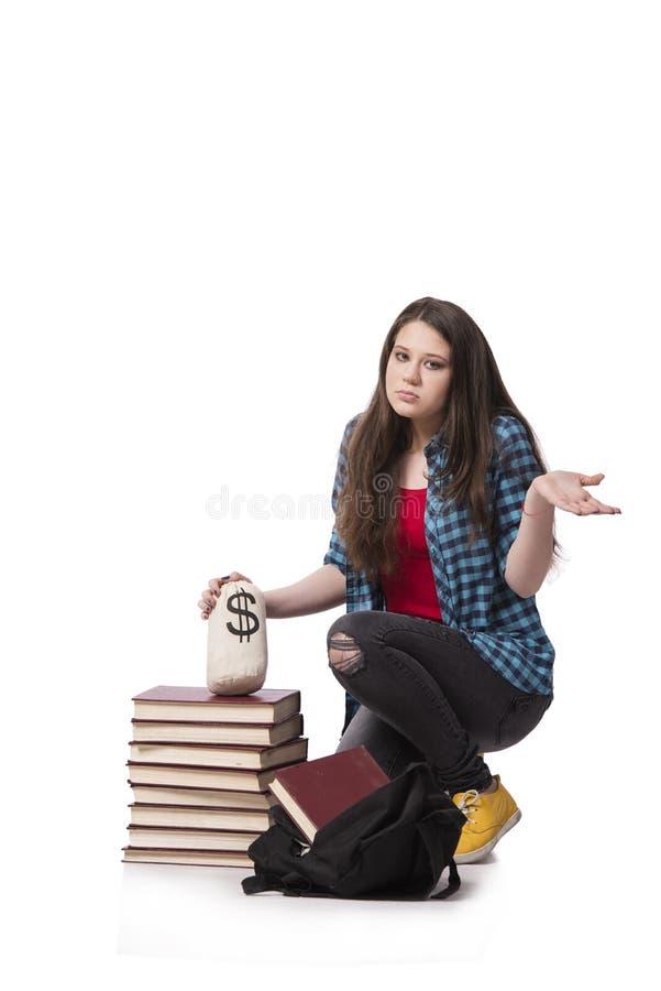 Il concetto di istruzione costosa con la studentessa fotografia stock