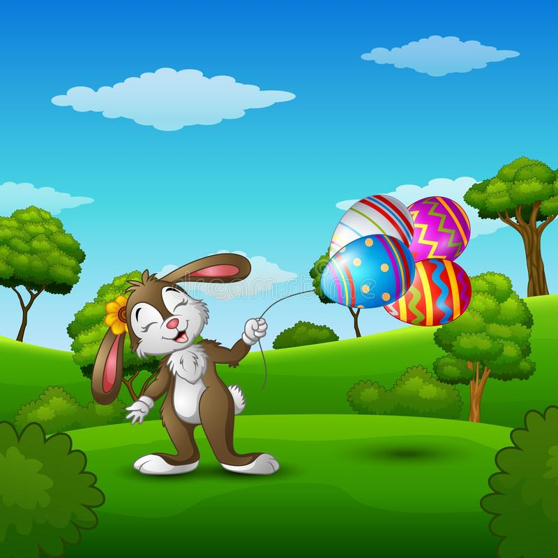 Il coniglietto di pasqua che tiene le uova di Pasqua balloons nel parco illustrazione vettoriale