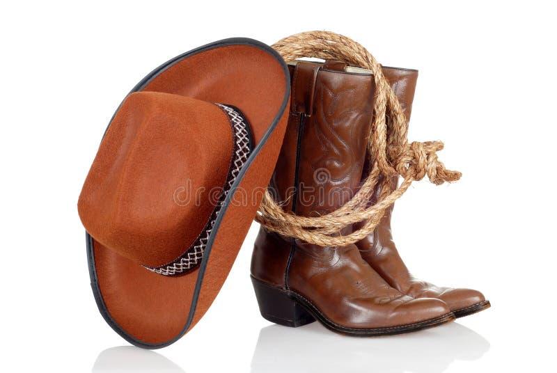Il cowboy caric il sistemaare il cappello ed il lasso immagine stock