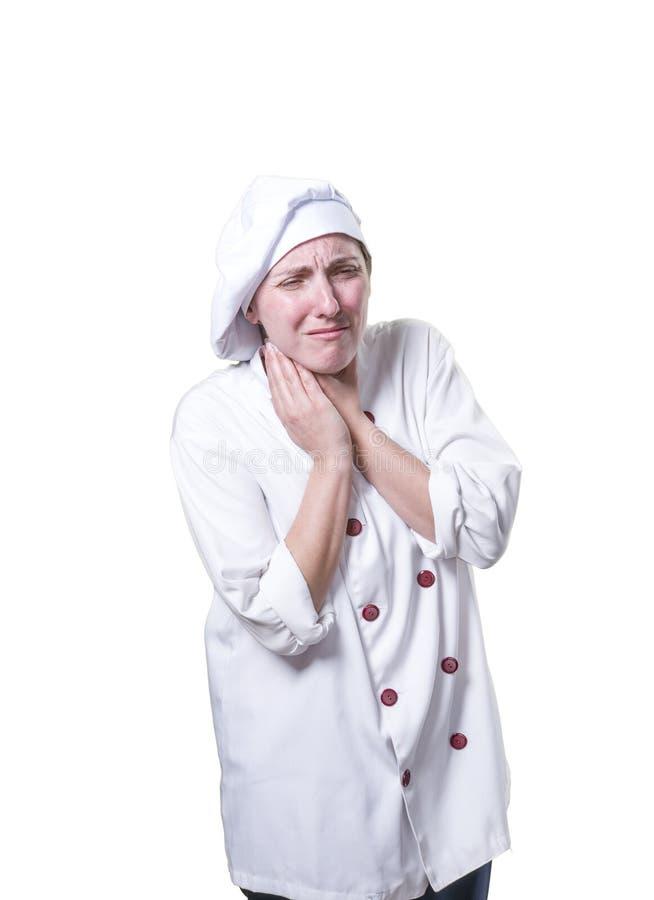 Il cuoco unico della giovane donna ha dolore al collo è soffre fotografia stock libera da diritti