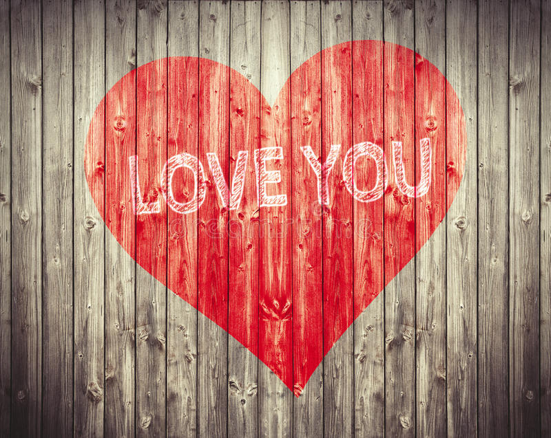 Il cuore rosso e vi ama frase su fondo di legno Simbolo romantico dipinto immagine stock libera da diritti