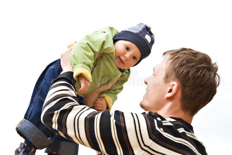 Il daddy che tiene il bambino immagini stock